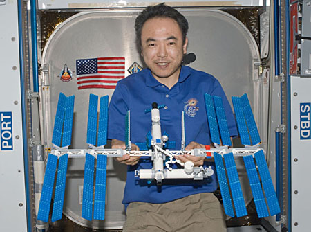 Japanese astronaut Satoshi Furukawa poses with a LEGO model of the International Space Station on the space station. (NASA)