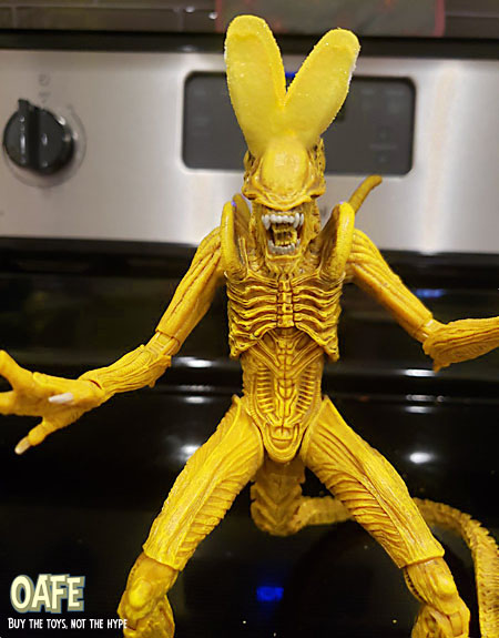 a full-grown yellow Alien with large marshmallow bunny ears