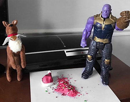 Thanos stands over the remains of Elf on a Shelf