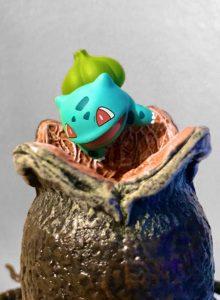 Bulbasaur looks into an open Xenomorph egg