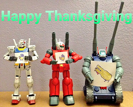 Three Gundams have drawn hand-turkeys: two with standard five-fingered hands, one with large double-barreled guns