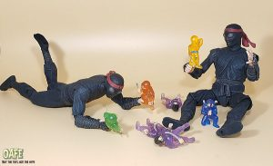 Foot soldiers sitting on the floor playing with smaller ninja figurines