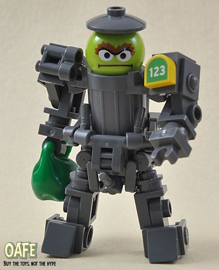 Oscar the Grouch in a trash can mech suit