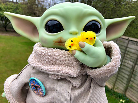 Baby Yoda shoveling yellow felt baby chicks into his mouth