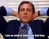 """Michael Scott with his hands behind his head saying """"I am so used to being the bad boy"""""""