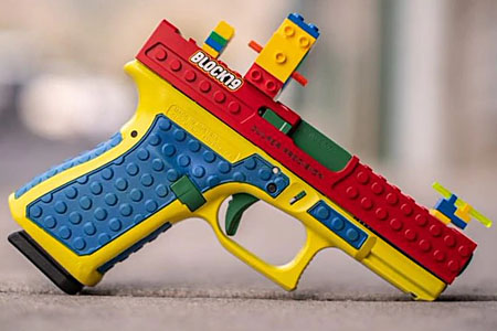 a colorful gun with bumps that make it look like it's made of Legos